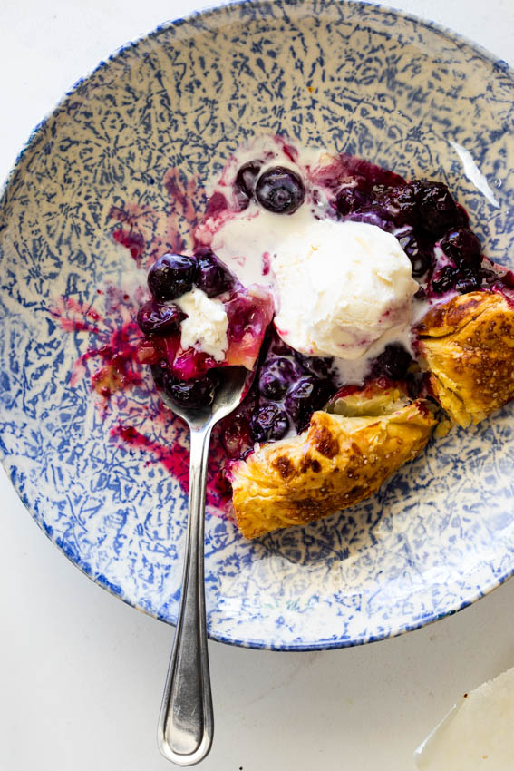 Blueberry galette with ice cream.