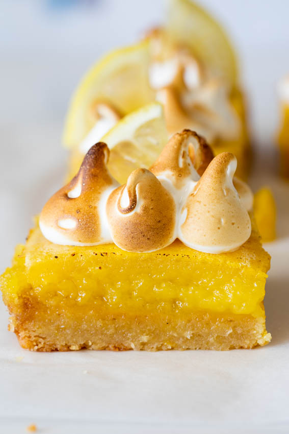 Gooey lemon bars with torched meringue.