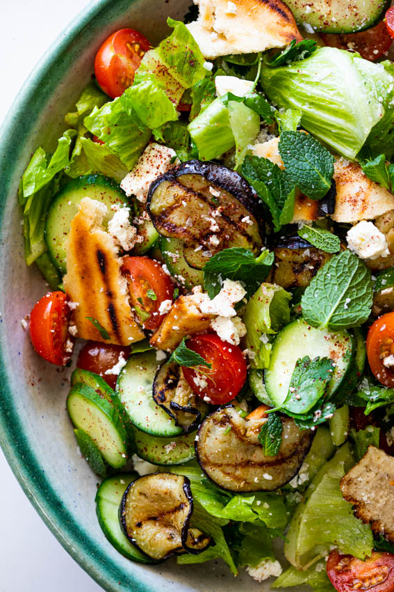 Salad with grilled pita bread, eggplant and feta cheese.