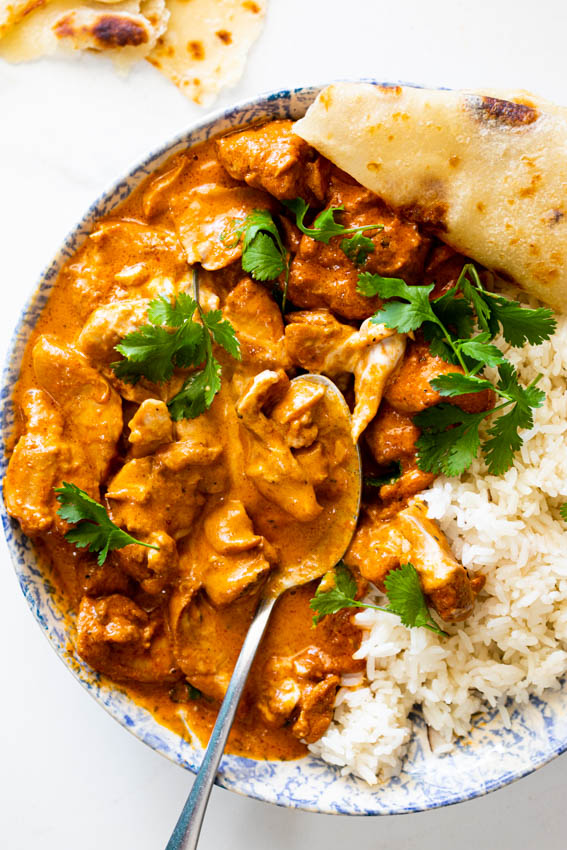 Butter chicken with rice and roti.