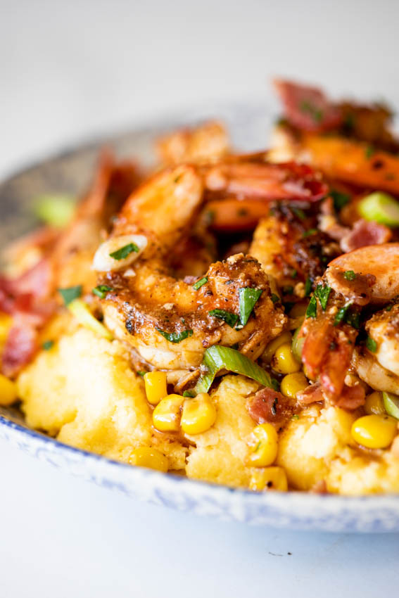 Shrimp and grits with bacon and corn.