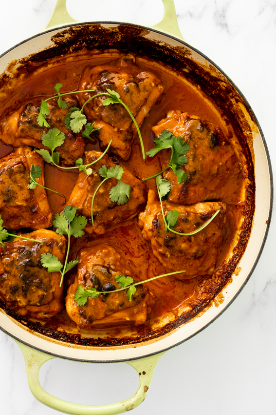 Coconut braised chicken thighs with cilantro.