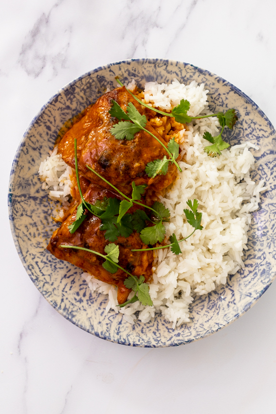 Coconut braised chicken thighs with rice.