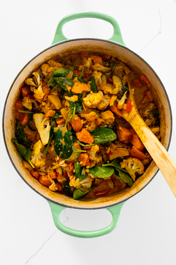 Vegetable curry ingredients in pot.