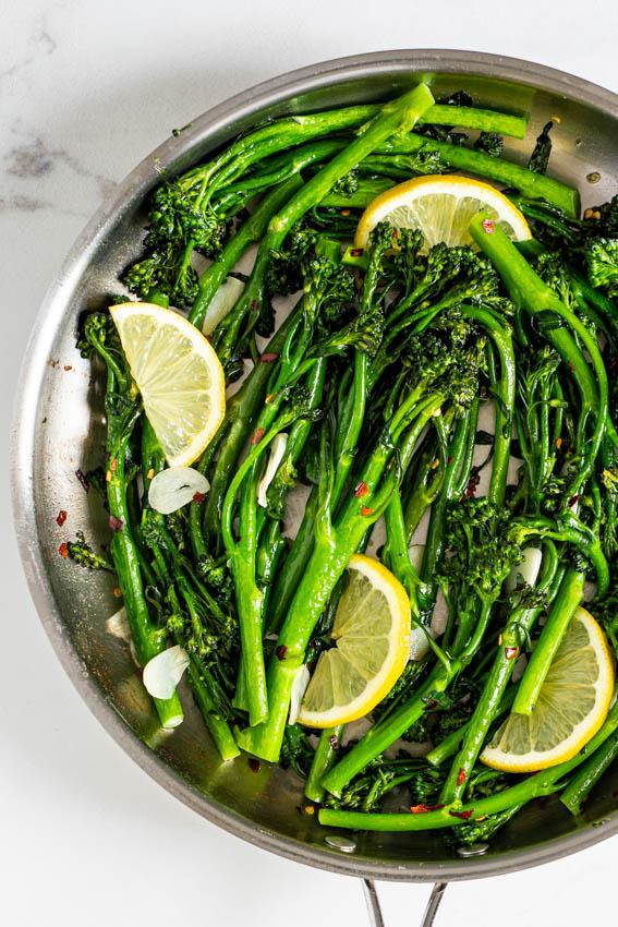 10-minute lemon garlic sautéed broccolini in pan.