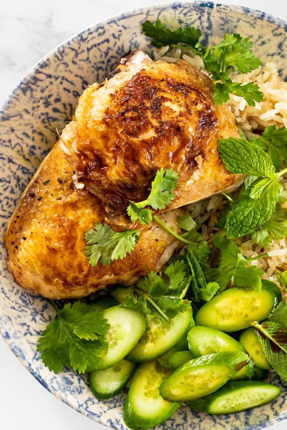 One pan ginger chicken and rice served with soy dressing, cucumber and fresh herbs.