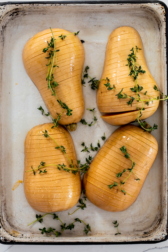 Hasselback butternut squash with fresh thyme.