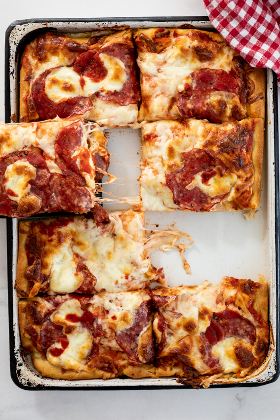 Super cheese pan pizza with salami.