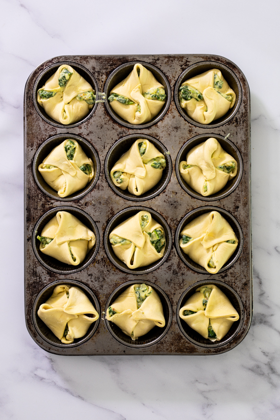 Pastry puffs with spinach artichoke filling.
