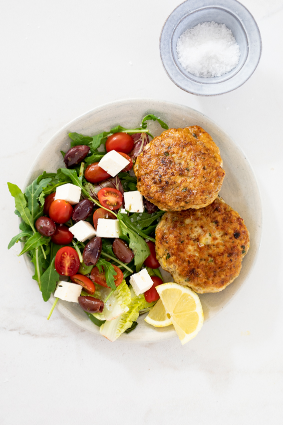 Lemon Parmesan chicken patties with salad.