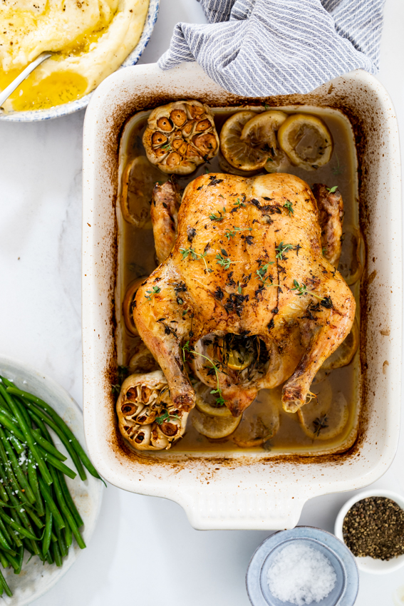 Juicy roast chicken with lemons and garlic.