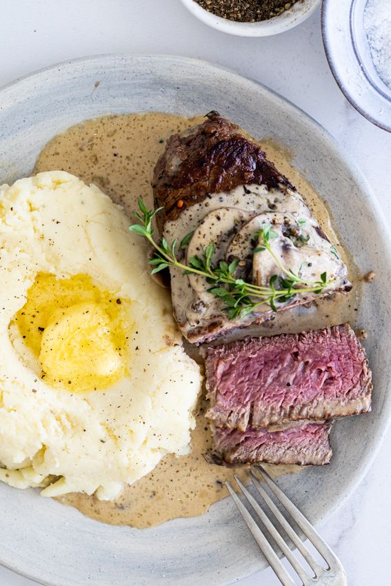Perfectly cooked beef fillet with truffled mushrom sauce and mashed potatoes.