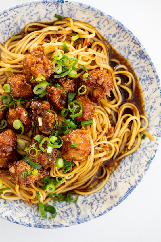 Crispy pork with saucy spicy noodles
