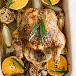 Roast chicken flavored with orange, sage and garlic.