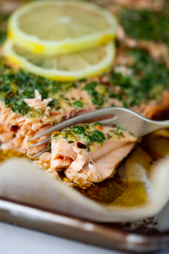 Succulent baked salmon flavored with garlic herb butter
