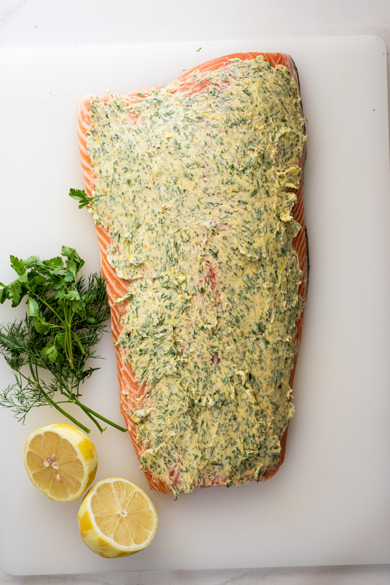 Side of salmon rubbed with garlic herb butter.