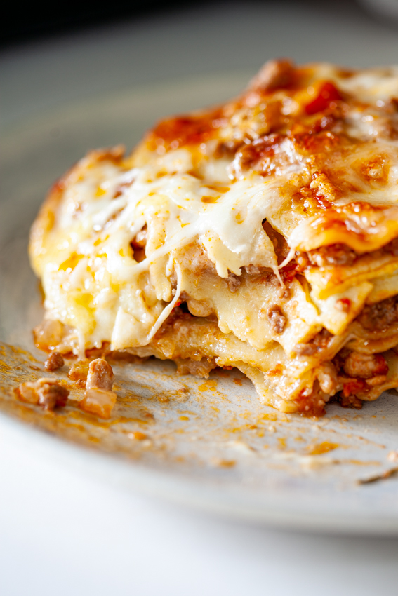 Layers of pasta, bolognese sauce and cheese sauce makes homemade lasagna the ultimate comfort food.