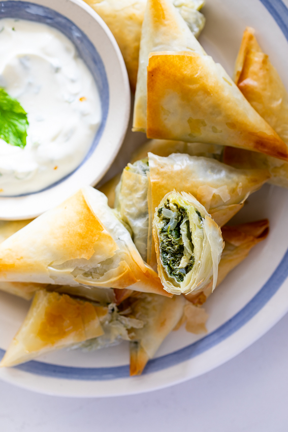 Phyllo dough filled with cream spinach and feta.