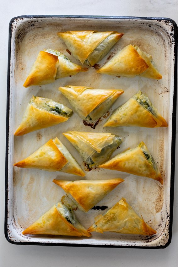 Mini Spanakopita on sheet pan.