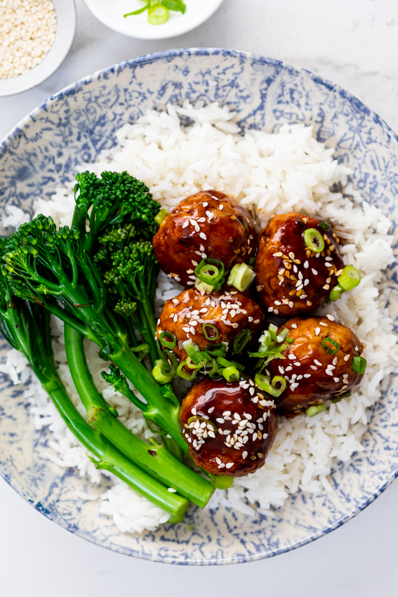 Sticky Teriyaki Chicken Meatballs with rice and greens.