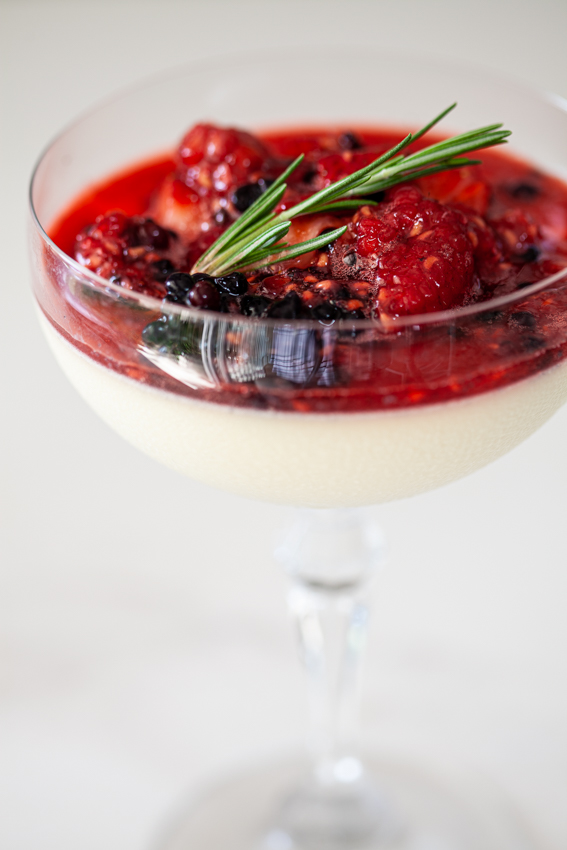 White chocolate panna cotta with macerated berries