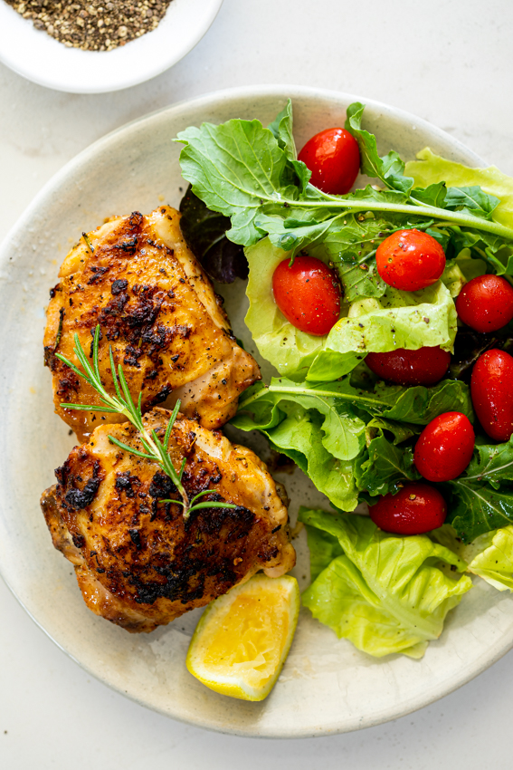 Lemon Rosemary Air fryer chicken thighs with salad