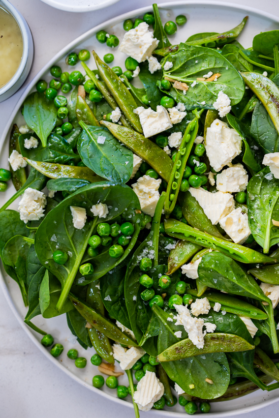 Warm Spinach Salad with Feta and Peas
