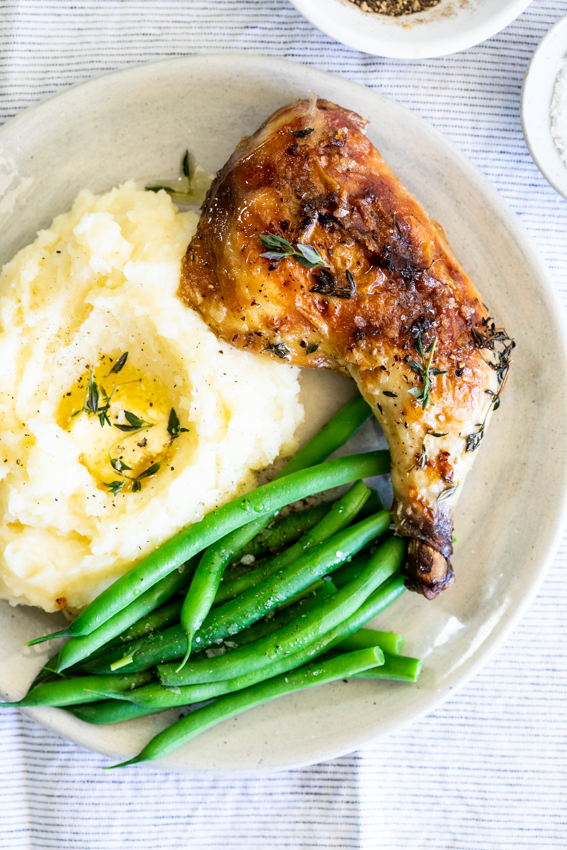 Buttermilk roast chicken with mashed potatoes and green beans.