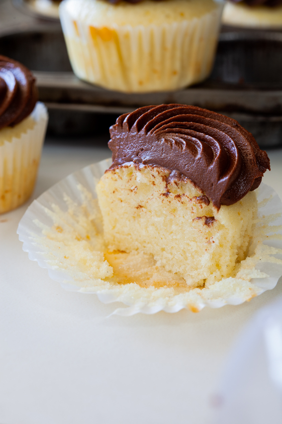 Vanilla Cupcakes with Chocolate Frosting.
