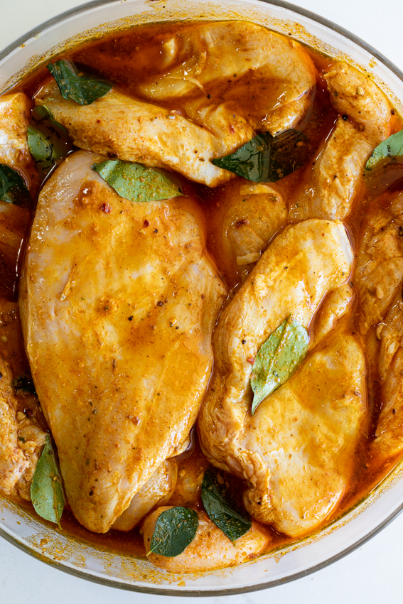 Chicken breasts in curry marinade.