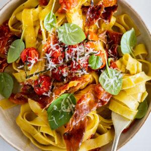 Easy cherry tomato pasta with prosciutto and basil