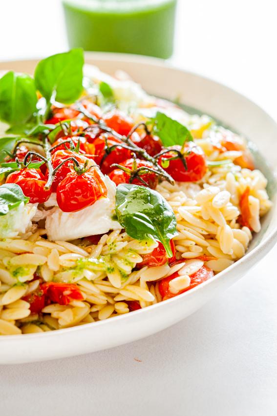 Warm orzo salad with roasted tomatoes, mozzarella and basil