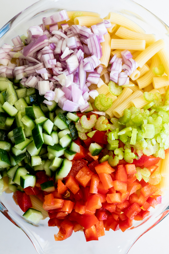 Curried macaroni salad with peppers, cucumber and peaches.