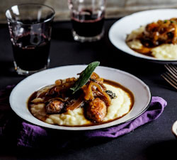 Sage-roasted pork sausages on mash with the ultimate onion gravy