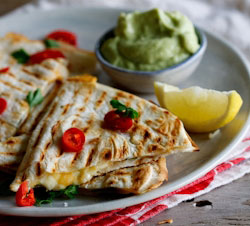 Spicy chicken and feta cheese quesidillas with guacamole